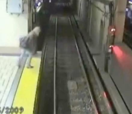 This Drunk Lady Stumbles Onto The Subway Tracks With The Train Just a Few Hundred Feet Away