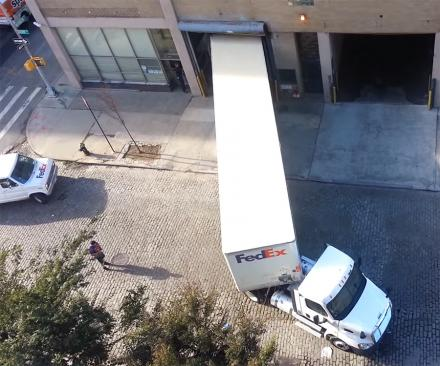 This FedEx Driver Backs Up Into a Dock Around a Tight Corner, and It